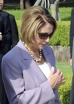 U.S.  House Speaker Nancy Pelosi offers prayers for the victims of the 1945 atomic bombing at the Hiroshima Peace Memorial Park