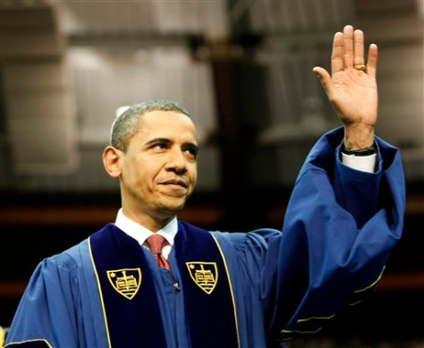 President Barack Obama waves as he arrives to deliver the commencement speech during the 2009 graduation ceremony at the University of Notre Dame in South Bend, Ind. Sunday, May 17, 2009. (AP Photo/Gerald Herbert)