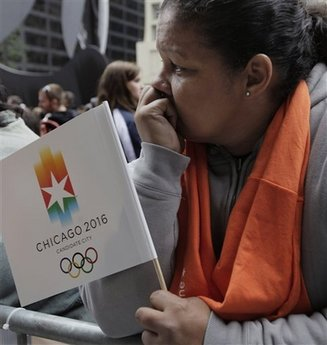 A Chicago 2016 supporter reacts following the announcement from the 121st International Olympic Committee on the host city